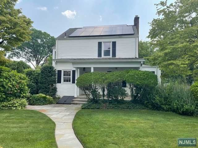 This is a truly unique home in lovely private secluded setting/prime area of Bergenfield close to Houses of Worship, parks, transportation etc. Hardwood floors on first floor, pine on second. Central air with 5 zone gas/HW heat (replaced 2014 with new flu liner as well). Hot water tank (replaced 2018). U/G sprinklers. Attic fan. Gorgeous outside covered porch & more. New roof (October 2021) both house and garage.