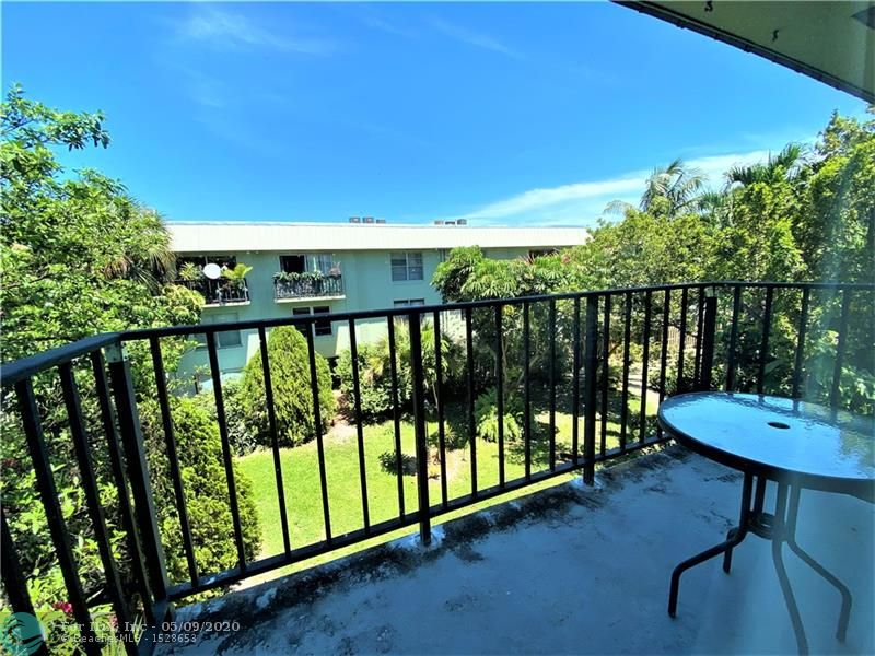 Great unit on the East side of Ft. Lauderdale just adjacent to Wilton Manors.  Large 1,000 Sq. Ft unit with balcony over looking a very pretty tropical garden area.  Unit includes an updated open Kitchen with Wood Cabinets, Upgraded Stainless Steel & Black appliances, Granite counters, double Stainless Steel sink and Custom Breakfast Bar.  Massive Living / Dining Room perfect for entertaining. Open Living / Dining concept, perfect for today's Lifestyle.  Custom Built in Storage in both Bedrooms.  Updated bathrooms and Washer / Dryer in the unit.   Prime Gated community which features a Large Pool, Sundeck, Gym and Clubhouse.  Lots of guest parking available as well.  Close to the Beach, Shopping and Nightlife.  Great Place to call home..