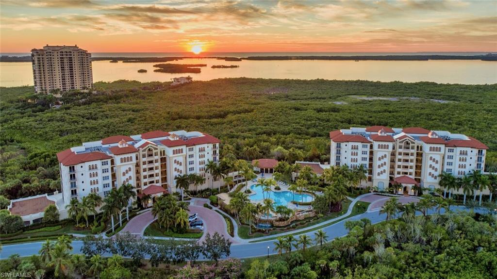 C7669 - Amazing Western views of the Gulf, Estero Bay and the Mangroves from this 6th floor – 6 floors over a garage – end residence at Castella at The Colony boasts 3 bedrooms and 3 1/2 bathrooms. Offered FURNISHED with over 2600 square feet of living space and one of the largest lanais in the community. Enjoy the resort-style swimming pool and spa with social pavilion and firepit. Custom master bedroom closet, freshly painted in the newest palette,and with 2 covered parking spaces, a large storage closet, and electric hurricane shutters.  Residents enjoy a 34 acre beach park, tennis, pickleball, canoe and kayak park, fitness center, membership and waterfront dining at The Bay Club.  Two golf clubs are available for optional membership.  Close to dining and entertainment and SWFL International Airport.