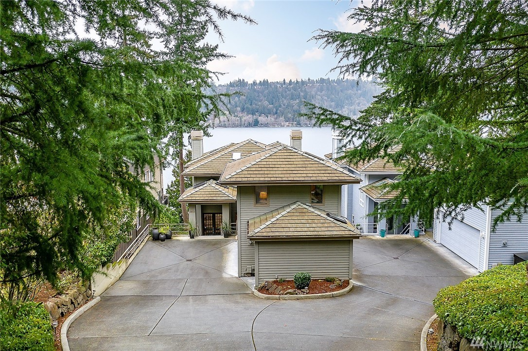 High above it all, commanding spectacular views of Lake Sammamish, this welcoming home captivates, and invites friends to stay awhile. The 5 bedrooms/ 6 baths, soaring ceilings and 4,380 sq ft open floor plan mean there's plenty of room for everyone. A sweeping staircase leads you down to your own private beach, 60ft covered dock with boat/jet-ski lift and 50ft of prime waterfront. Guests can choose separate lakeside cottage or guest wing! Close to everything and phenomenally priced!