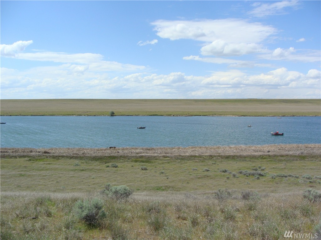 Over 230' of Waterfront / No Bank Lakefront Property, 9.67 Acres Total with Endless Possibilities, Build Next to the Lake, or up on top, Your Choice, Beautiful Western Views of the Lake and the Mountains, just Minutes away from the Airport, and just 10 Minutes from Downtown Moses Lake or Ephrata. Waterfront Acreage is getting harder to find. Build Your Dream Home on this Great Waterfront Property!