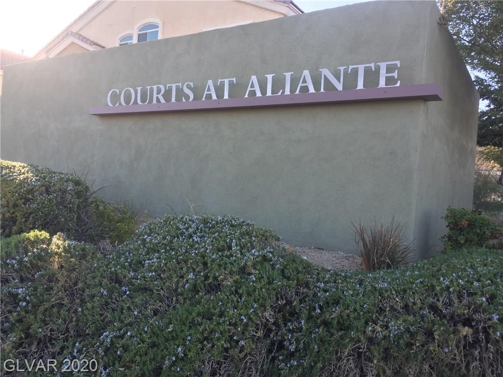 Lovely Townhouse with vaulted ceilings and attached garage in a gated community within Aliante. Master bedroom separate from Second room. Ceiling Fans throughout and all appliances included. Easy access to shopping, schools, freeways, library and ALL that Aliante has to offer.