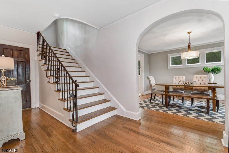 Welcome home to this meticulously maintained, 5 bed/3.1 bath classic brick colonial in the heart of Maplewood, convenient to jitney/town/train. Upon entering you are greeted by a large foyer, generously sized living room w/ wb fireplace, updated chef's kitchen w/ new floor, ss appliances & large center island, open to formal dining room, private office, sun room & powder room. Upstairs, the master suite is spacious w/ a private bath.  In addition, you have 3 large bedrooms and an updated hall bath.  Finished 3rd floor offers a bedroom, full bath & lounge area - perfect guest/in law suite. Lower level features large rec room, laundry, storage & access to attached 2 car garage. Enjoy entertaining in the private, fenced yard w/ large patio, grill & shed.