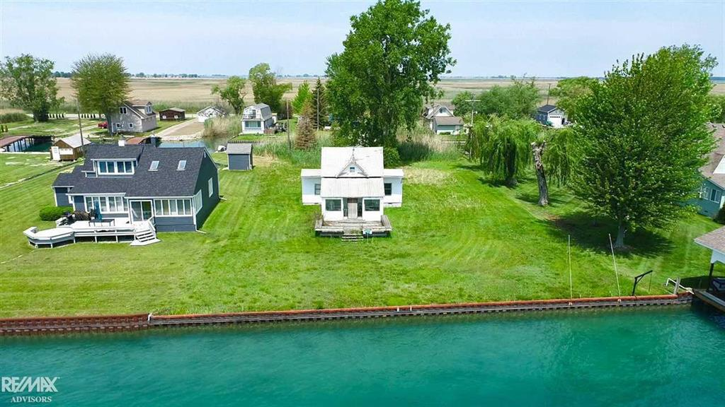 """105' on South Channel!!! Watch international ships from around the world on this glorious spot on the Shipping Channel!!!  Steel Seawall. Across from the """"Bassett Channel"""". This location will NOT disappoint! Newer foundation.  Sunroom with windows galore to watch all the waterfront activities. Protected rear canal with bridge to drive to your private oasis! Locations like this do not pop up often. House needs a new families love and memories to fill it up. Value in the land...PRIME LOCATION!"""