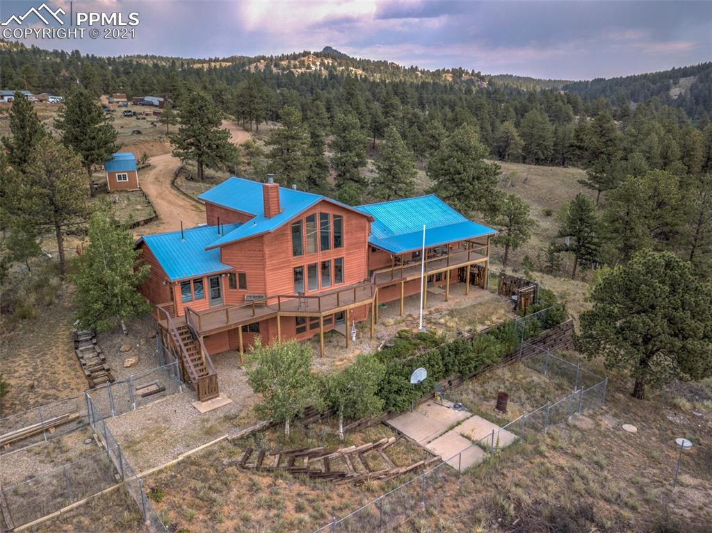 Views, Views and more Views -  this beautiful  1.5 story 4744 sq ft home sits on 40 gorgeous acres.  Location is not too far from Hwy 24, zoned A-1 and no covenants.  Walk into the home and you are greeted by a wall of windows in the great room that has 180 degree views from Pikes Peak, Mt Pisgah and westerly mountain views.