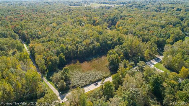 Great Vacant land parcel, 36.96 acres total, zoned residential in Sumpter Township. The sale to include property ID# 81038990002000 & Property ID# 81038990003000.