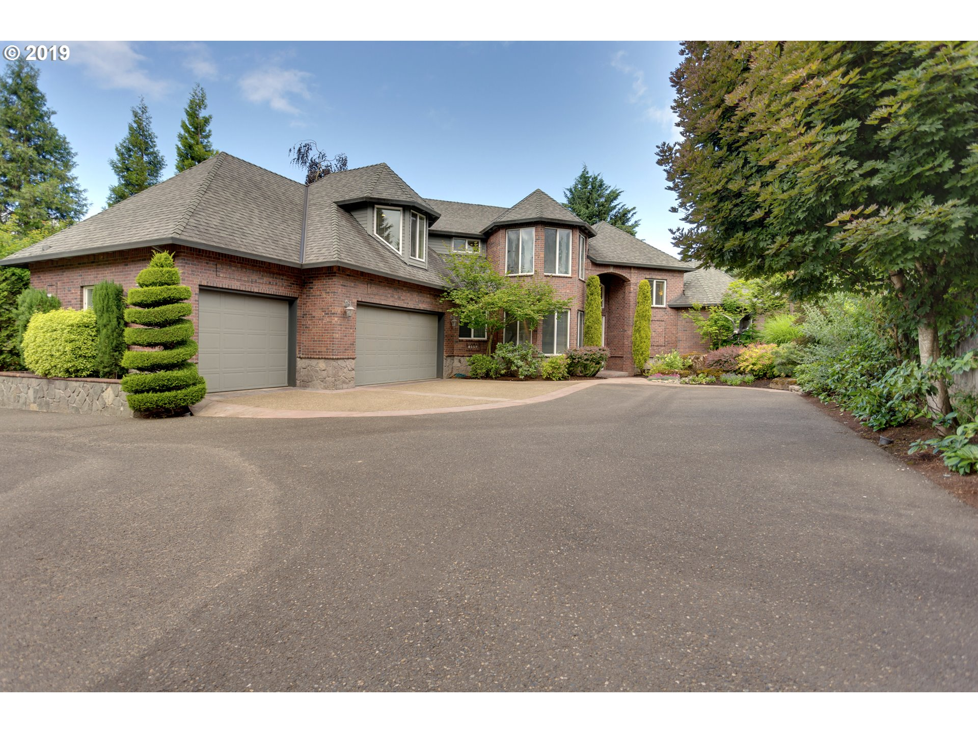 Custom built close-in Beaverton home on 1/2 acre designed ideally for entertaining & busy families. Beautiful professional landscape creates a private oasis with pool, koi pond & spa. Master on main w/ 4 bdrms upstairs, each with it/s own sink to ease hectic school mornings. Laundry rms on both floors. Close to Jesuit and OES. Easy access to Nike, Intel & hi-tech corridor. Quarter acre adjacent lot available to purchase.