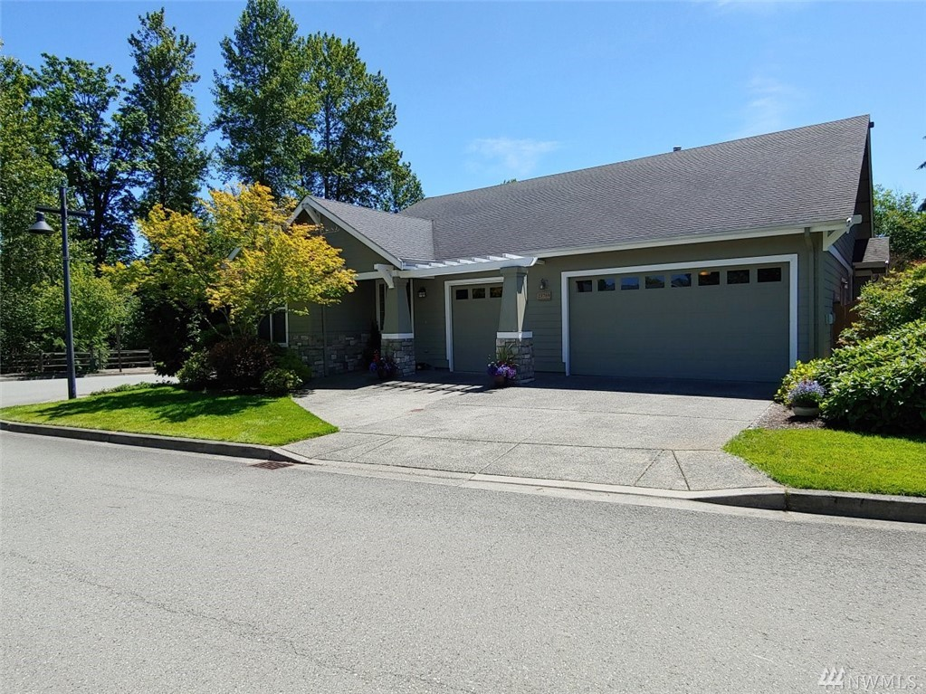 This 2 Bed 2.5 Bath plus Den Craftsman Style Rambler in the Active Adult Community of Trilogy (55+) boasts Hardwood Floors In Entry & Kitchen with Breakfast Nook. Huge Living Room, Family Room with 3 Sided Gas Fireplace & 3 Car Garage! Bay Windows In Family Room & Master Suite. *NEW* granite in kitchen and Master bath. New carpet throughout and tile in Master bath. Fresh paint throughout. New hot water heater.