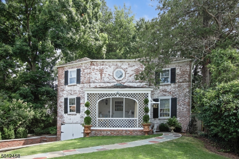 Stunning French Colonial 4 Bed, 2 Full + 2 Half Bath home located steps from Taylor Park + blocks to NYC train and top-rated public schools in sought after South Mountain. Sumptuous private patio. Great flow for entertaining w/ a renovated Gourmet Kitchen with ss appliances, granite tops & breakfast area, LR w/ FP +built-ins, formal DR, and 1st FL Home Office. Exquisite details include decorative moldings, custom cabinetry, and built-ins. Large Master Suite. Phenomenal finished Lower Level w/ Family Room. Powder Room + access to attached Garage. The MOST romantic screened porch plus meticulous English Gardens and fenced rear Patio. One block to downtown Millburn s shops + restaurants and 4 blocks to 2000 acre S. Mountain Reservation make 42 Whittingham a must-see home in the ultimate convenient location!