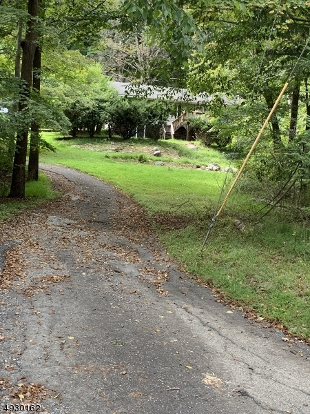 "Make this country gem your own, nestled on 3+ tranquil acres. This home features full basement waiting for your personal touches.  Cozy up in the cooler months around the pellet stove. Newer floors in Living Room. Dining Room and hallway. Great opportunity to bring your ideas and make this place ""HOME""  Driveway in need of repair"