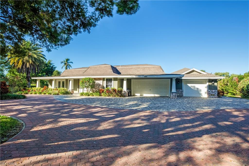 ONLY 3 BLOCKS TO BEACH!!  Ideally situated on over half an acre, parklike setting on a corner lot.  Recently renovated interior, detached poolside cabana complete with a full bath, a full bar, and nicely appointed outdoor kitchen.  This home also has a large apartment/guest wing attached to the main house.  Open floor plan with large kitchen and family opening up to the pool, hot tub, and outdoor fire pit.  Versatile floor plan that can configure up to 6 bedrooms if needed.  This is Florida living at its finest within easy walking distance to Naples fabulous pristine white sand beaches.  Also a very short ride to downtown to enjoy all that Olde Naples has to offer.  This house can easily be enjoyed as is now and serve as a pristine building lot in the future.  At over half an acre, this is the largest available lot in Coquina Sands.  This location is second to none!