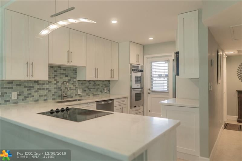 Check out this completely remodeled and upgraded, first floor, end unit, three bedroom, two bathroom condominium. This unit boasts upgrades including double wall oven, stainless steel appliances, quartzite countertops and much more! This community is very well taken care of and centrally located in Broward county. This unit also has the same floors throughout the entire condo with the exception of the master bathroom. Come take a look!