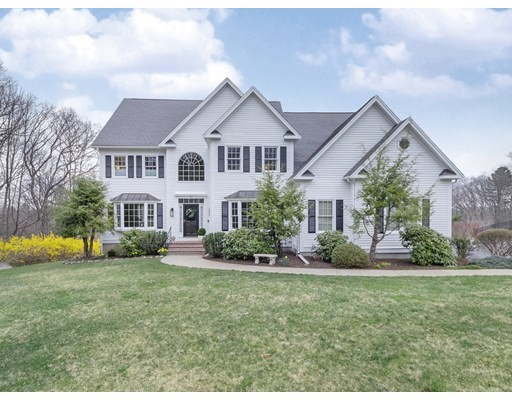 Sited on 1.47 acres in one of Southborough's most sought after neighborhood, located in a cul-de sac with picturesque views, this lovely colonial welcomes you with sun filled interior, quality finishes throughout, including hardwood floors, custom cabinetry/granite counters and a high end Bose system included*.  First floor highlights include a welcoming Family Room with Vaulted ceiling/Skylight, open concept from the Living Room to the Dining Room, a gourmet Kitchen with updated custom granite counters/SS appliances. Patio doors lead to a oversized mahogany deck with great views and landscaped yard.  The second floor features a lavish master with Bermuda Tray ceiling separated by a French door leading to a tranquille reading room, spacious walk in closet and elegant master bath, 3 additional family bedrooms, 2 full baths, and laundry area. Lower tier offers a walk out basement to a family fire pit surrounded by nature.