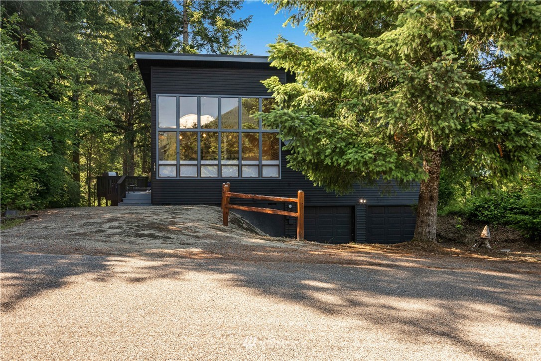 Located in Packwood's premier Skyline neighborhood is this beautifully remodeled NW contemporary chalet with stunning views of Mt Rainier. Take in sunsets over Tatoosh from the wall of windows in the open concept main living area. The main level is wrapped in decking with a newer in-deck hot tub and covered dining area. Skyline is the closest neighborhood to Packwood for convenient access to groceries, dining, White Pass Ski Resort, and Mt Rainier National Park. Store your snow equipment and river toys in the oversized attached garage. New standing seam metal roof, new furnace and heat pump, fresh paint inside and out, new flooring, slab surfaces, and baths! This home is ready for your immediate enjoyment or for a profitable rental!