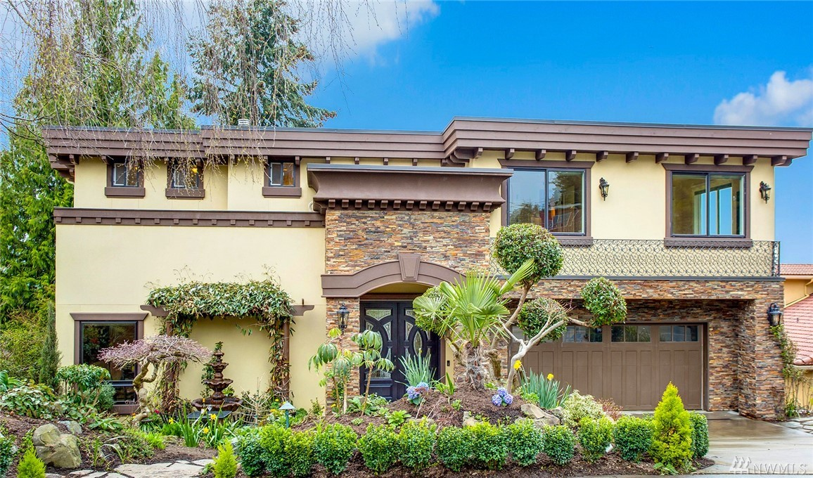 A Mediterranean masterpiece in the heart of Houghton! Fully renovated in 2013, this home enjoys bright western exposure, picturesque sunsets & stunning views of Lake Wash, Olympic Mtns & the Seattle skyline! Soaring entry leads to luxurious Great Room accented w/crown molding, large windows & sweeping views! Open kitchen w/SS appliances & granite counters. Spacious master suite w/fireplace & spa-inspired bath. Covered patio & 2 view decks! Lower level w/full MIL suite w/kitchen, bath & laundry!