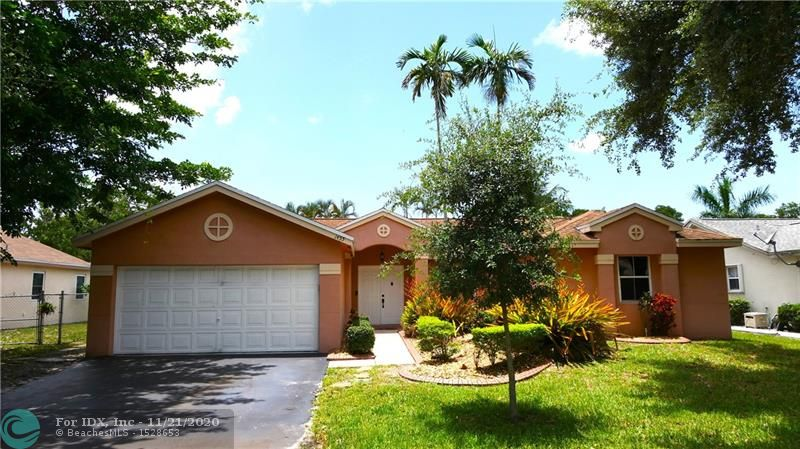 Perfect for a small family or first time homebuyers in the private community of Hammock Estates. One of the largest lots in the community with backyard on a wide canal. Two car garage and wide driveway. Newly installed shatter-proof French doors leading to the backyard. Newly added front loader washer & dryer set, water heater, and A/C unit. Home has an open floor plan with vaulted ceilings, split bedrooms, wood-type flooring throughout, updated bathrooms, contemporary paint, stainless steel kitchen appliances, plus lots more! Walk to school, parks, and shopping centers; close to major highways.