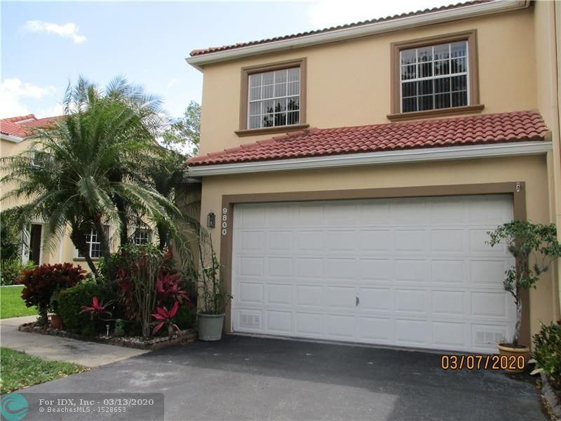 "Spacious 4 bedroom 2 1/2 bath corner end townhome in desirable Coral Palm Village overlooking the canal. This home boasts over 2333 square feet under air along with a large two car garage providing extra storage. One of the many desirable features of this home include a generous master suite with walk in closet along with double sink vanity, separate shower and Roman tub, wood floors in bedrooms along with a laundry room upstairs. Wonderful open floor plan that consists of 18"" neutral diagonal tile, updated kitchen including granite countertops, lots of natural light and French doors leading out to a nice sized covered private patio to relax overlooking the peaceful canal. Close to the pool. Wonderfully maintained community conveniently located, gated and within a good school district."
