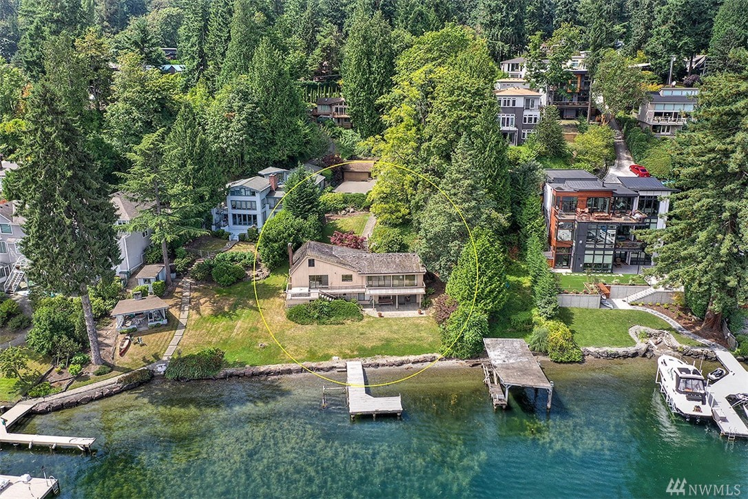 First time to market in 50 years, opportunity to own this just-shy of an acre Mercer Island homesite with approx. 103' of no bank waterfront.  Three bedroom, three bath home is livable while you plan your dream home on the building site just steps from Lake Washington with Mount Rainer views.  Potential to subdivide the large, gradually sloped lot to multiple homesites with waterfront and water and mountain views.  Dock and deep water moorage.  Private drive.  Value in the land.