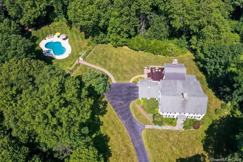 Tucked back off the road w/ property you could only dream of in Weston. 2+FLAT LUSH ACRES w/gorgeous plantings & pool w/ spectacular setting! Privacy, yet only MINUTES to schools & town! A meticulously maintained home w/LARGE gracious rooms;oversized LR w/fireplace, dining room, 2 extra bonus rooms on main level - one w/ built ins for an office & the other right off the kitchen w/ skylights & banked windows that could be the perfect playroom or another office.Master w/ FP, generous master bath w/ his & her walk in closets. 4 bedrooms (one en suite perfect for guests)But the heart of the home starts w/ the expansive kitchen leading to the PERFECT family room. Not only is the FR HUGE, it has 12 foot+ ceilings, a 2 story FPL & it's filled with light! This is the room that will bring everyone together.Set in the ideal location,right off the kitchen, allows for a wonderful flow for parties or simply relaxing. Perfect day scenario - grab a cold drink in kitchen, step into the FR maybe read a book for a little while, then make your way out the french doors to the beautiful mahogany deck. Relax a bit in the sun on the deck before you head for a swim, quick walk down a cobblestone path leading directly to private pool area set among stunning perennial gardens. It's the trifecta! A beautiful spacious home in EXCELLENT condition on a magnificent piece of property in a fantastic location! It's difficult to find a home w/all these wonderful qualities but this is it - the perfect package! Tucked back off the road with property you could only dream of in Weston… 2 + FLAT LUSH ACRES w/gorgeous plantings + a pool with a spectacular setting!  Privacy, yet only  minutes from schools &  town! A meticulously maintained home w/LARGE gracious rooms;oversized living room w/fireplace, formal dining room, 2 offices on the main level - one w/ built ins and the other with skylights & banked windows .  Master w/ fireplace, generous master bath w/ his & her walk in closets w/ built ins. 4 additi