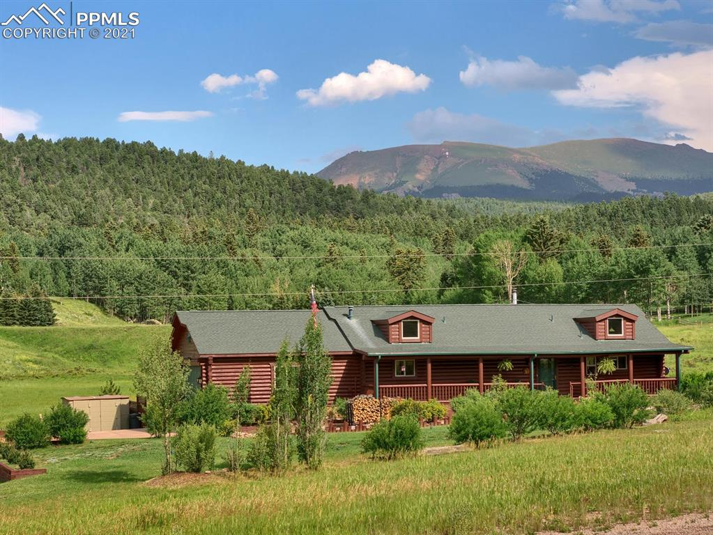 """Beautiful Colorado Log home that has that """"WOW"""" factor! It looks like the homes you see in log home magazines. Captivating Pikes Peak views with a large rear 8x52 deck & a private hot tub/fire pit area to enjoy the views from. This home has plenty of windows to bring in the natural light & to also enjoy the beautiful views. Every room is warm & inviting. Immaculate property which shows pride of ownership. There are many upgrades along with Hickory cabinets, a large walk in pantry, a 6x52 covered front porch & SO much more!"""