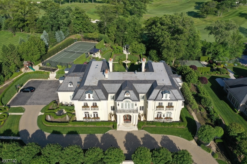 Welcome to an architectural masterpiece with gracious French Chateau inspired design details. Developed by renowned builder and designer to the stars Robert Zampolin, this warm and majestic open floor plan consisting of over 18,000 +/-  sq ft of opulent living space. This magnificent estate located in one of the most prominent zip codes in Bergen County is nestled on approximately 1.45 gated acres of immaculately maintained landscaping with exceptional gardens. This estate is truly built by a craftsman with the intent to endure many generations. Features include, banquet sized rooms with high ceilings, detailed millwork and impressive scale entertaining spaces.  The residence is in award winning school district, backed up to the Montammy Golf Course and just minutes from NYC.