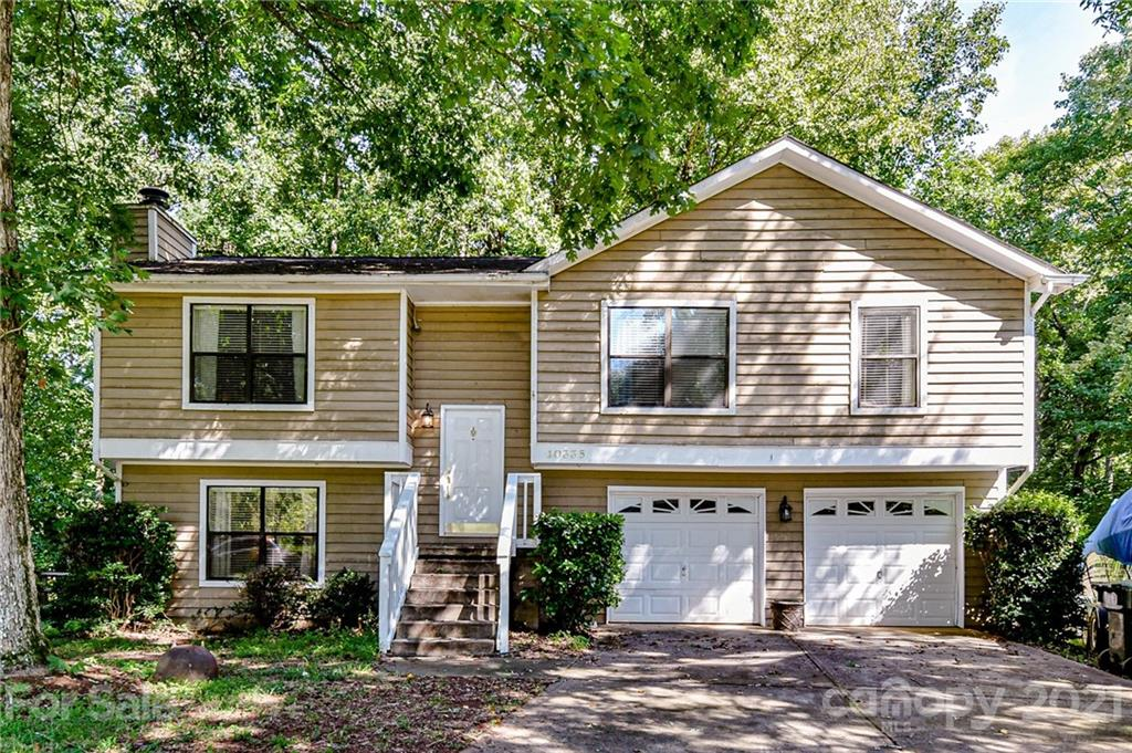 Enjoy country like living in this wonderful updated home, nestled on a 1/2 acre cul sac lot, in great Mint Hill location! Large Great Room with stone fireplace, vaulted ceiling and gleaming hardwoods floors. Dining area is open to the spacious Kitchen that has been remodeled, new white cabinets, granite countertops, tile backsplash, farmhouse sink, appliances, tile flooring and recessed lighting. HUGE lower level bonus room. Multi level decking at rear, perfect for entertaining, large cookouts, etc. Backyard is a kids dream!  8x8 treehouse, and lots of area to run and play! 400 sq. ft. wired outbuilding/shop.  Oversized finished 2 car garage and double car driveway for extra parking.  Just minutes from downtown Mint Hill, restaurants, shopping, parks, coffee houses and I 485.