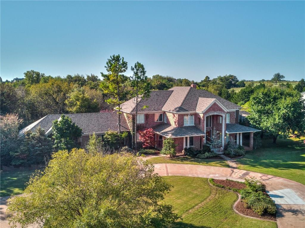 THIS ONE TRULY HAS IT ALL: Secluded paradise located on two heavily wooded 5.02-acre lots. Brings pleasure both inside and out. Expansive living room has 20-foot ceiling and a picturesque Florida room with a three-trunked palm tree, water feature and rows of towering windows. Impeccably crafted oak woodwork throughout. Multiple storage areas. Marble front entry. Kitchen has Italian granite counter tops, built-in Sub-Zero refrigerator, feature lighting, walk-in pantry and wet bar area. Master suite has sitting area and loft study/exercise room. Breathtaking backyard features pool, hot tub, rock waterfall, covered/uncovered patios and master bedroom balcony overlooking it all. Has greenhouse/garden area, fishing pond with tiki hut deck, basketball goal on concrete slab and abundance of acreage to add your own features. Roof, AC units, heaters and water tanks all replaced in 2013. No HOA fees.