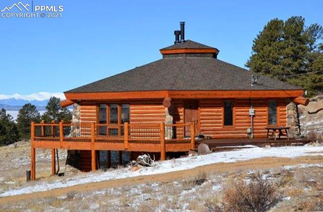 562+/- Contiguous & Conserved Acres ~ Stunning Views of the Snow-Capped Collegiate Peaks ~ Surrounded (3) Sides by Pike National Forest ~ (3) Ponds & Multiple Springs ~ Octagonal Log Home, Remodeled 2018 ~ Historic Barn ~ Rustic One-Room Day Cabin (No Water or Electric) ~ Trophy Wildlife includes Elk, Mule Deer, Antelope, Bear, Turkey & More ~ Large Groves of Aspen & Pine ~ Hay Meadows ~ Livestock Friendly w/ Numerous Acres of Grazing Land ~ Partial Fenced Perimeter ~ Access from Paved US Hwy ~ Gated & Private