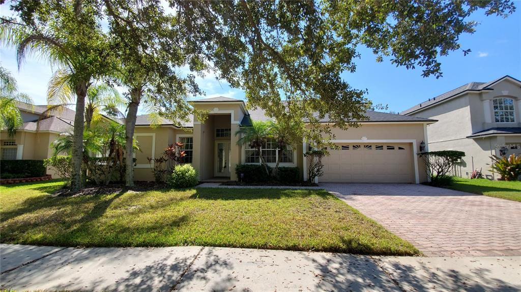 This lovely remodeled  home with 4/3/2 /1 office/1 bonus room  in a gated community of Tampa Palms is ready to move in. NO CDD fee! Excellent schools! The house is facing  a lake.  It features high ceilings, crown moulding, window case, open floor plan and split bedrooms. New roof was installed in May of 2021, AC was replaced in 2015, water heater was replaced in 2016, fresh painting exterior wall.  Brand new water proof vinyl floor through family room, kitchen, dining room, living room, two bedrooms, and master bedroom. The kitchen was just remodeled  with brand new granite counter top and backflash,  brand new stainless microwave, stove, dishwasher. 42'' cherry wood cabinets; Brand new showers in master bathroom and pool/guest bathroom;  brand new granite counter top, brand new light fixtures, faucets in  bathrooms. The large master bedroom boasts 2 walk in closets and a large en-suite bathroom with a Tub and double sinks. The office is next to the master bathroom,   one large  bonus room with closet  is on second floor, it can be fifth bedroom too. Two  bedrooms share a full bath. This home features a formal living room and dining room  and also added a screened  patio and fenced backyard for entertaining in the back, Enjoy the big fenced paved backyard.  Club Tampa Palms includes a clubhouse, luxury community pool, kiddie pool, spa, fitness center, playground, tennis courts, basketball. Close to Major Highways I75 and I275, USF, Outlet Mall, Wiregrass Mall, Hospitals and shopping center; Flatwoods Nature Park for walking, biking and rollerblading! You don't want to miss this AMAZING HOME!
