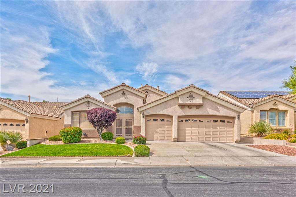 A rare find in Henderson, three bedroom single story home in Anthem Estates with dual master bedrooms. Has formal living room and separate dining room. Great layout and open floor plan. Kitchen features a large island with Corian counter tops and opens to a spacious family room with gas fireplace. Mature landscaping with oversized patio cover in private backyard. Three car garage is finished and includes abundant storage cabinets.