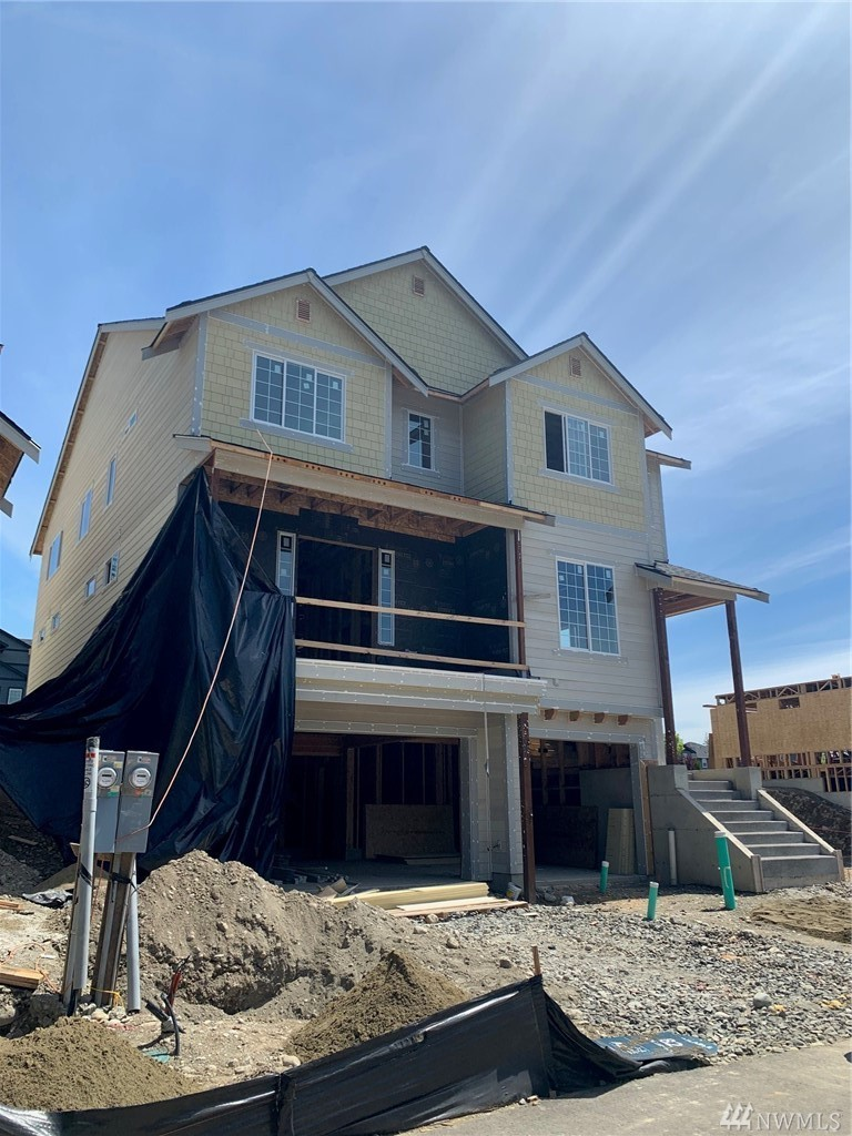 """Est completion for November! The new Tamarack floor plan offers 3,912 sqft w/5 bdrms, 3 bth, Great Room, Formal Dining, Chef's Kitchen, Bonus Room, & 5-pc Deluxe Master Bathroom. Interior includes hardwood package, granite slab, SS appliances, 5"""" white millwork, & tankless water heater. Exterior features cement siding, stonework, covered outdoor living, rooftop deck, oversized 3-car garage, fully fenced, & backyard landscaping. Over $64K in upgraded options included. Amazing view of Mt Rainier!"""