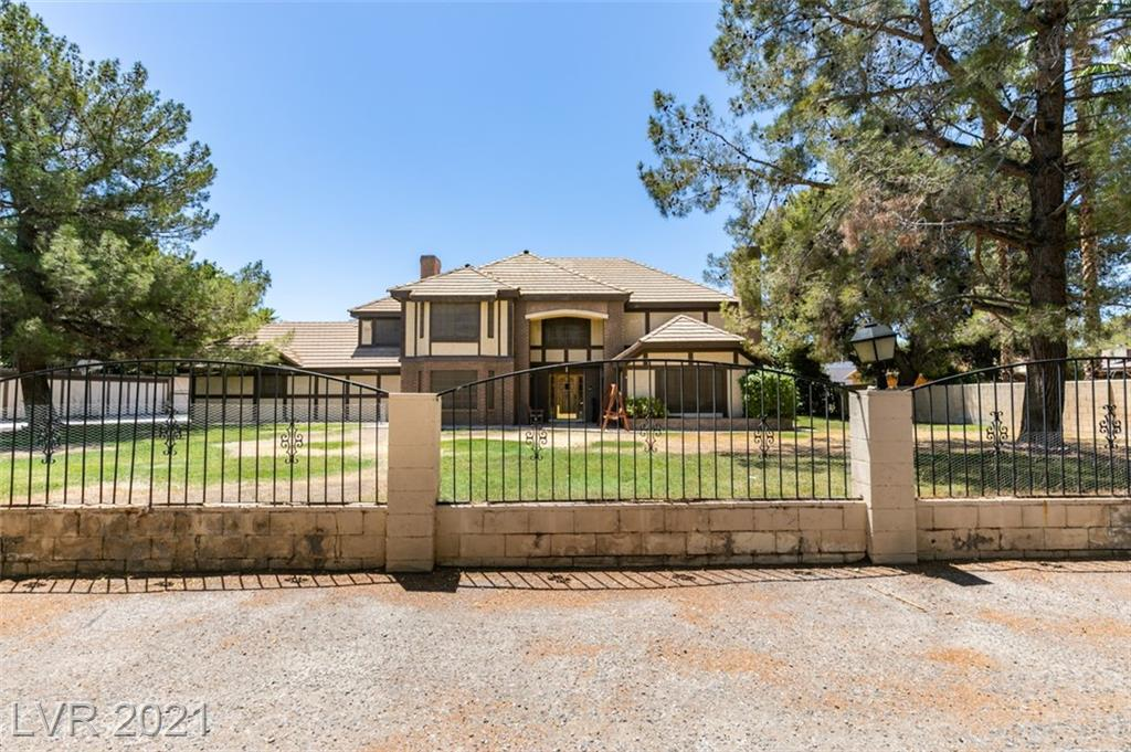LARGE PRIVATE ESTATE IN THE CENTER OF TOWN!  1/2 ACRE!  NO HOA!  ALMOST 5,000 SQ FT!  THIS CUSTOM ESTATE WAS BUILT IN 1984 BY PROMINENT VEGAS ATTORNEY!  4 LARGE BEDROOMS!  4 FULL BATHS!  4 FIREPLACES!  GARAGE HAS BEEN CONVERTED INTO A HUGE MULTIPURPOSE ROOM!  BASEMENT THAT IS PERFECT FOR A MOVIE ROOM!  TONS OF STORAGE!  BEUATIFUL CUSTOM POOL WITH WATERFALL AND SLIDE!  THIS HOME NEEDS A LITTLE UPDATING AND TLC AND IT WILL BE A TRULY AMAZING ESTATE!  THIS HOME IS PERFECT FOR ENTERTAING - LARGE FAMILY - OR AIR BNB/ VACATION RENTAL!  THIS IS A MUST SEE IF YOU ARE LOOKING FOR SOMETHING CENTRAL TO TOWN AND 1 OF A KIND!