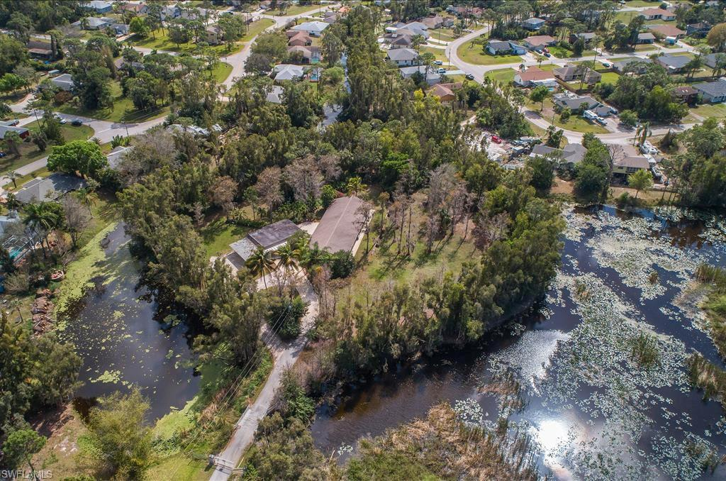 """""""CYPRESS ISLAND"""" 1.7 ACRES PRIVATE """"ESTATE"""" ISLAND W/ 2 HOMES 7 BEDROOMS, 3 BATHS! BEAUTIFUL GROUNDS W/ MANY NATIVE CYPRESS TREES AND ORANGE TREES THROUGHOUT THE PROPERTY. MAIN HOME HAS 5 BEDROOMS, 2 BATHS VAULTED WOOD CEILING ACCENT THE HOME AND THERE IS TILE FLOORS THROUGHOUT. IT HAS A """"HUGE"""" LIVING/ ENTERTAINMENT ROOM (36 x 36). THE GUEST HOME HAS 2 BEDROOMS, ONE BATH AND A ONE CAR GARAGE BUT COVERED PARKING FOR AN ADDITIONAL 5 CARS IF NEEDED. THIS PROPERTY WAS FORMILY AN AIRBNB & VRBO VACATION RENTAL PROPERTY. WE CAN PROVIDE THE INCOME & EXPENSE. DUE TO SELLERS BEING OUT OF THE COUNTRY IT IS CURRENTLY BEING RENTED TO FGCU MEN FRATERNITY AND GENERATES OVER $57,000 YEAR AS A YEARLY RENTAL. THIS UNIQUE ISLAND PROPERTY COULD BE PERFECT FOR PRIVATE SPORTS CLUB, CHILD DAY CARE, ARTIST OR WRITERS DESTINATION, YOGA RETREAT OR CORPORATE RETREAT. OWNER FINANCING IS A POSSIBLE OPTION."""