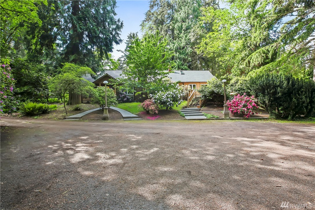 4bd/2ba secluded 1937 home on .92ac w/ ADU & so much potential you will have to see it. Home is cozy & quaint with bonus rooms/hid away rooms for storage/hide away. Beautiful mature cedar trees and rhododendrons. Spring time will be full of color. This property has a detached garage w/ shop space, 2 carports w/ guest hse(ADU) above garage, w/ 1bd/1ba, full kitchen w/ granite counter tops, dining room, living room & bonus attic space for storage/bonus room. Commuters dream 2 min. to Ferry term.