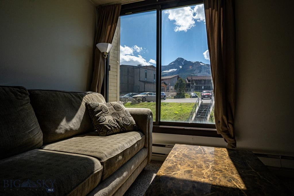 Here is an opportunity to own an affordable studio great Lone Peak Views! This is a first level unit in the Alpe d' Huez Bldg. This would be a great rental opportunity for full time living! Walking distance or short drive to skiing, biking, hiking and everything else Big Sky Resort base area has to offer!