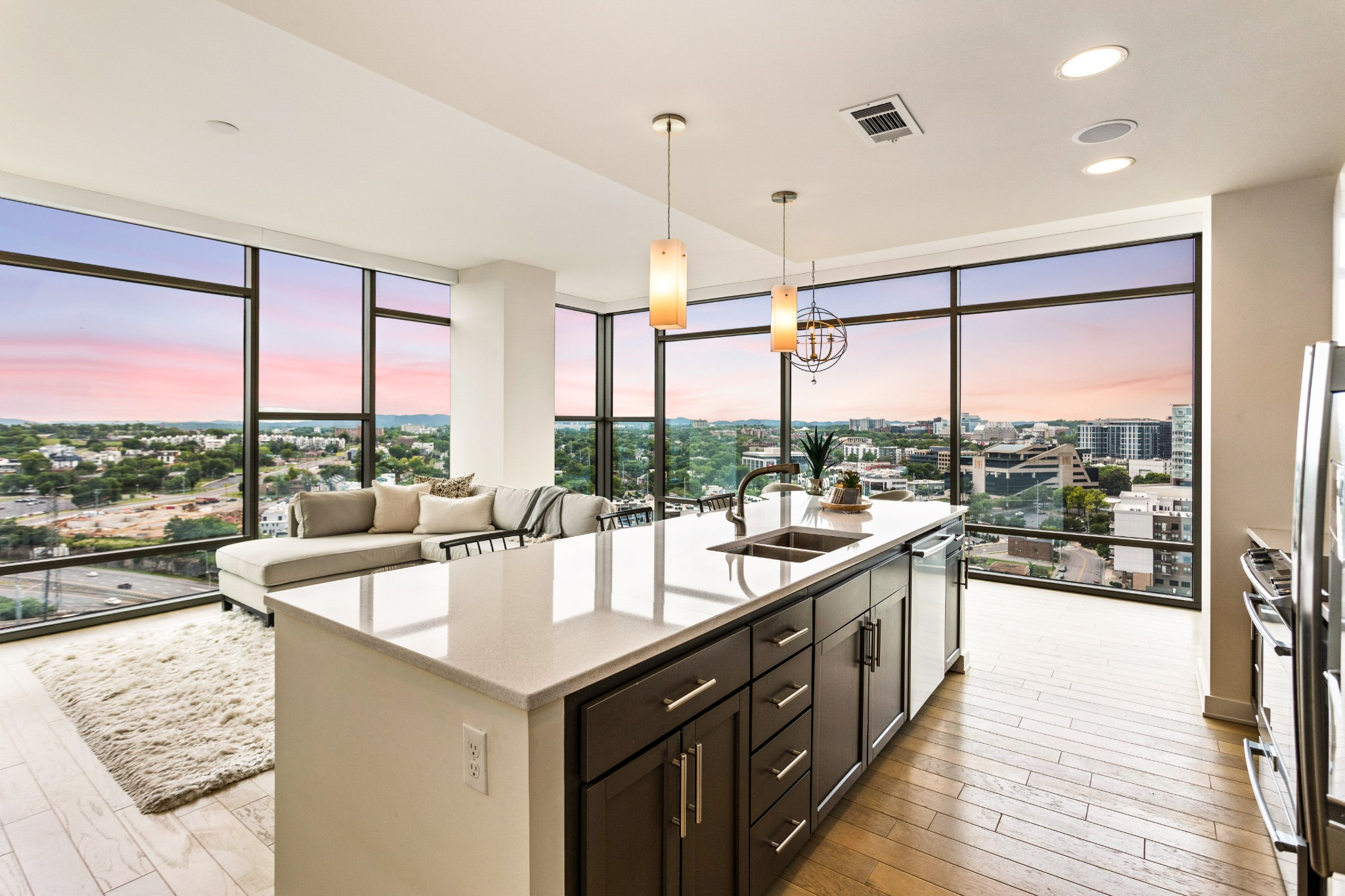 Amazing corner 2-bed condo of Nashville's most desired high-rise developments! Unit offers incredible sunset views & includes all kitchen appliances, W/D, motorized window treatments, & custom California Closets; 2 parking space, #32 & #34, & a 5x6 storage space, #32, will convey with the unit.