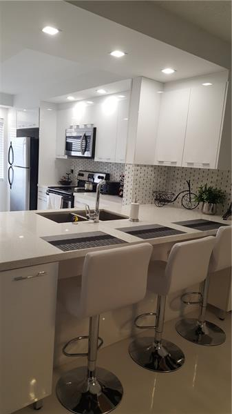 VERY BEAUTIFULLY AND ELEGANTLY RENOVATED 2/2 CONDO IN THE HEART OF BROWARD COUNTY. VERY SPACIOUS MASTER BEDROOM WITH TWO WALK IN CLOSETS. KITCHEN HAS STAINLESS STEAL APPLIANCES, GRANITE COUNTER TOP, RECESSED LIGHTING, ELEGANT CABINETS WITH BEAUTIFUL CABINETS HANDLES. WASHER AND DRYER IN UNIT. THIS CONDO IS RENOVATED AND FURNISHED WITH A HIGH CLASS TASTE OF ELEGANCE. ALL FURNITURE IS GIVEN FOR FREE TO A FULL PRICE OFFER. BUYER CAN RENT AFTER ONE YEAR OF OCCUPANCY. RENT CAN NOT BE LESS THAN TWO CONSECUTIVE MONTHS AND NO MORE THAN TWO TIMES A YEAR. BUYER WILL KEEP AN AMOUNT EQUAL TO SIX MONTHS OF MAINTENANCE IN THE ASSOCIATION ESCROW FOR EIGHTEEN MONTHS.