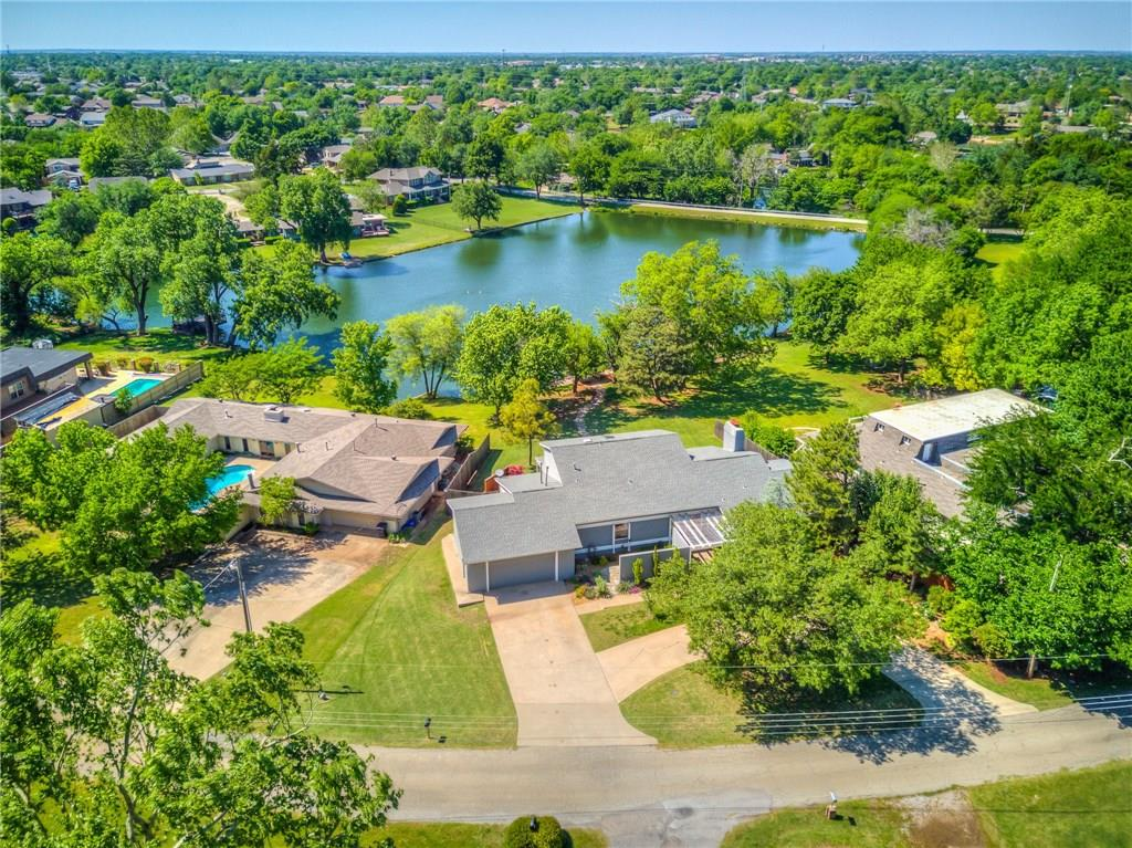 Lake living in OKC! Fishing, bird watching, relaxing, entertaining, romancing, resting, escaping, you name it! Beautiful Silverlake home on a half acre. Contemporary and unique home is tri level and most rooms have view of lake. Private deck off masterbed w/ view of lake and dock. Huge bedrooms, 4th bed can also be used as study/office. Gorgeous huge living area built for entertaining! Remodeled kitchen and lots of wood flooring in living and dining areas. Brand new roof, gutters and skylights!