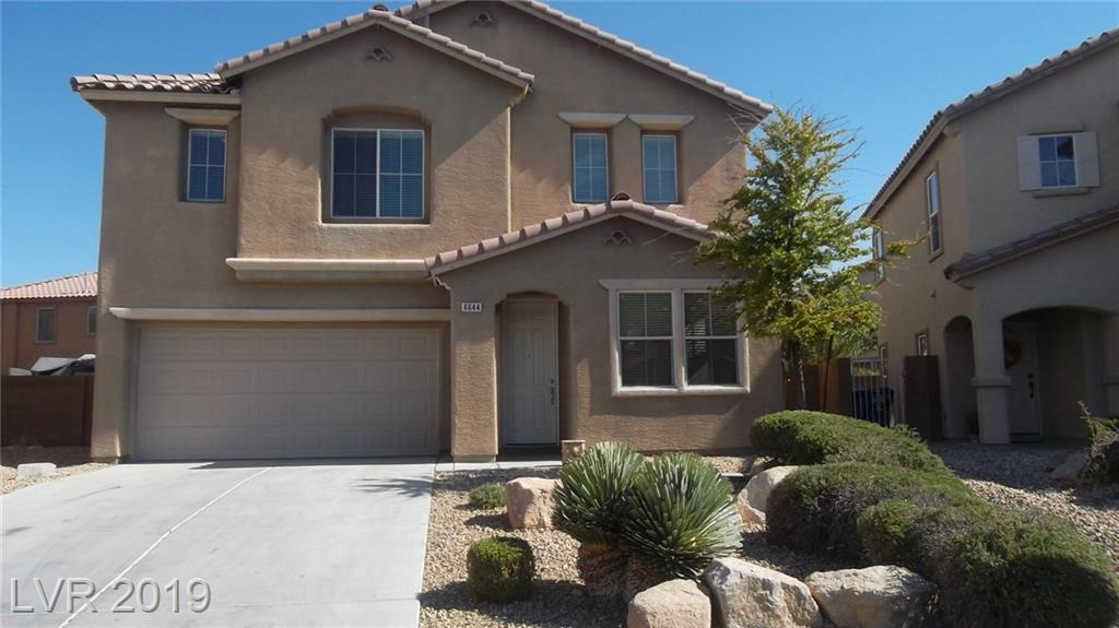 "Beautiful 4 Bedrooms Home in Aliante at ""Lavella"" Comm. right across from one of the Sport Parks, Features 9 Ft. Ceiling, Tiles Flooring, Granite Counter Tops & Island in Kitchen, Upgraded Cabinets, Double Ovens, Separate Family Room & Living Room, Master Bedroom W/Mountain View - Large Walk-In Closet, Double Sinks, Separate Tub & Shower, Front & Back Yard - Desert Landscaping w/Shrubs, Trees, and Large Patio."