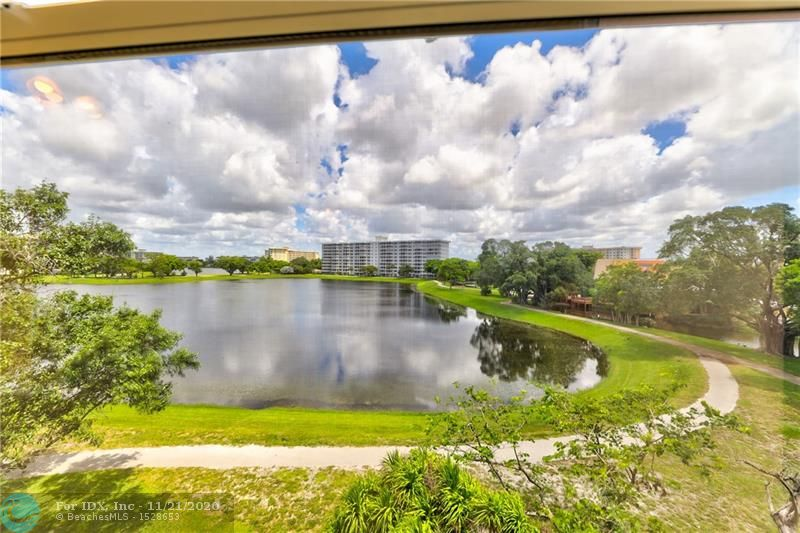 Palm Aire Country Club is an oasis of palm trees, lakes, golf courses, swimming pools, and walking trails in beautiful Pompano Beach. Close to world class recreation like Isle Casino, it also provides easy access to major thoroughfares. This spacious corner unit offers fabulous views of the lake, trees and endless skies. Impeccable and recently updated, it's ready for you to move in- remodeled kitchen with newer cabinets, stainless steel, and granite countertops. New carpet in 2 bedrooms, neutral tile elsewhere. Bathrooms have new vanities w granite (one shower, one w tub). Fresh paint throughout, enclosed balcony w breathtaking views. This unit is all light and beauty and, at this unbeatable price, it can be your personal retreat! Condo requires 10% down plus 1 year condo fees in escrow.