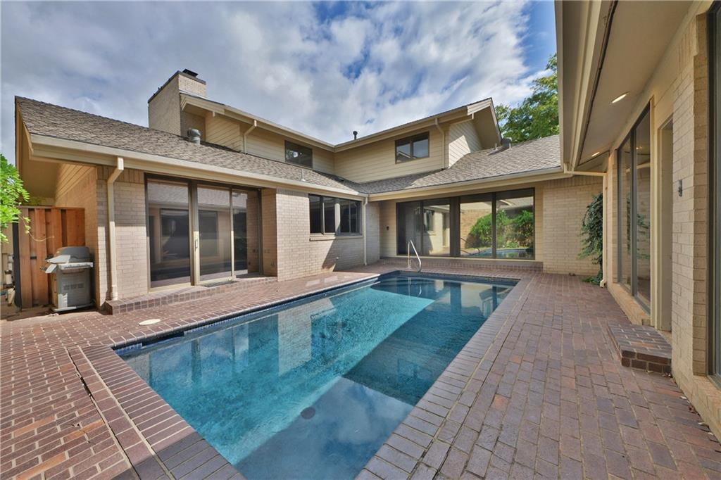 Chic, modern, & maintenance-light, this 3 bed, 4 1/2 bath home is truly golf-course living at its finest! East Oak portion of Oak Tree which means yard maintenance & exterior home painting every 5 yrs are covered in the additional HOA dues! Private pool in courtyard so no spectators but large windows from house overlook the pool. Cabana has kitchenette & full bathroom. Stunning fixtures throughout. Gorgeous quartz counter tops. Master bathroom has his & hers sinks, a make-up mirror,  AND separate toilets (not to mention stunning tile accent wall)! Upstairs bonus has fireplace, kitchenette, & access to balcony with great view. Mirrored door closets in every bedroom. Sliding glass Pella doors throughout. The utility room you deserve with plenty of counter space, awesome backsplash, cabinets for storage,  ironing board, deep farm sink. End the day in with either a soak in the courtyard pool or with a view & unwind on either the covered or uncovered patio--the choice is yours!