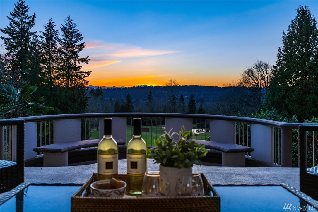 Contemporary masterpiece w/gorgeous sunset views of Olympic Mtn & golf course. Grand entry w/barrel vaulted foyer. Elevated viewing terrace for harmonious outdoor living & al fresco dining. Natural light Open Kitchen w/picturesque setting. Main Level Master Suite w/fireside seating, Juliette balconies, & dual walk in closets. 3 extra bdrms w/ elevated ceilings. Dedicated Recreation Rm & Office overlooking golf course scenery. Radiant floor heating thru-out. Bear Creek CC w/award winning schools!