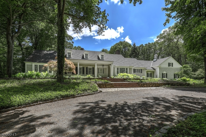 """""""Like new"""" extensively remodeled home on Bernardsville Mountain w/new kitchen, bathrooms, roof, windows, septic Offering park-like grounds including, brick terrace & walks, pool, lighted tennis court. Stunning """"Connecticut Colonial"""" on 6 +/- AC offers an oasis of privacy w/winter views, flowering trees, shrubs & perennials.Granite-block curbs. First-floor master suite w/sitting room & 2 of 5 NEW bathrooms. NEW Designer Kitchen w/fireplace. Family room w/fireplace, beamed ceiling,wet bar. Living room w/fireplace, dining room, powder room & mud room w/new bathroom complete first floor. On the 2nd floor are 3 more bedrooms, 2 baths, loft area, laundry room & bonus room. A wrap-around porch w/fireplace & front porch offer outdoor living. Approx $700,000 in renovations. Contiguous five-acre lot available."""