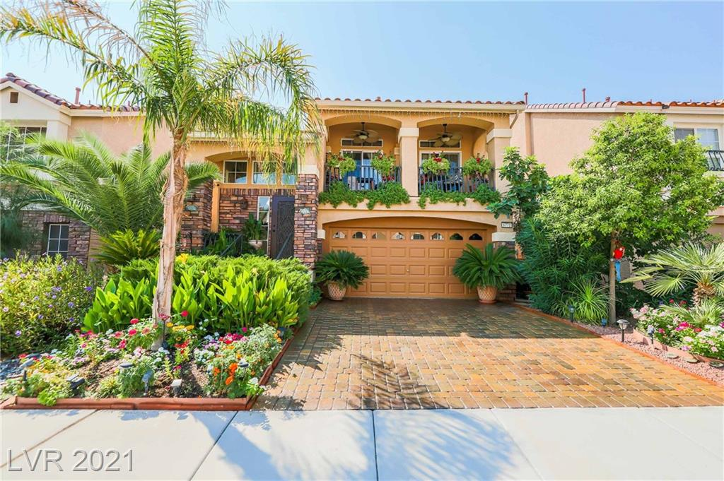 Gorgeous Southwest split level home by American West, like new 2012 build with upgrades galore. Lush resort like landscaping, paverstone driveway, raised covered patio entrance, & full length balcony in front.  Stunning baroque balcony railing & glass cutouts in entrance. Split level entrance with master bedroom, private laundry room, & master retreat downstairs. Master features ceiling fans, additional windows & slider in master for added natural light, surround sound, espresso cabinets & petra fina countertops and walk in shower w/ dual shower heads.  Open concept great room upstairs w/ additional canned lights, surround sound, ceiling fan & pocket windows.  Kitchen features upgraded espresso ceiling height cabinets, island, stainless steel appliances, pendant lighting, backsplash, & granite countertops. 2 additional bedrooms and full bath upstairs with petra fina finishes. Low association of $14/month. AC & H2O softener in garage. Easy access to dining, shopping, 215 and 15 freeway.