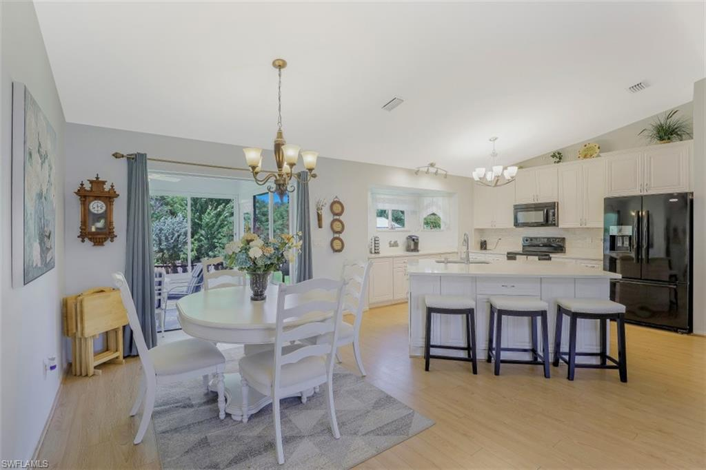 You will LOVE this charming home on Caloosa Rd in San Carlos Park! From the moment you pull into the spacious drive to the open great room, to the private, beautifully landscaped backyard, you will become more & more enchanted! The living, kitchen, dining & enclosed lanai are open to one another w/a large kitchen island serving as the centerpiece! The heart of the home is always the kitchen & this one is sure to be the gathering place for you & your loved ones. Vaulted ceilings, wood look flooring throughout, plantation shutters, completely updated -you won't want to leave! Steps from the kitchen is the all season lanai, where you will enjoy evenings w/friends & family over dinner & drinks.  Coffee is served each morning while you admire the landscaping & the wildlife that visits the fenced in backyard. There is a shed for storage and OH!! A delightful pergola with a swing!! The MBR suite has attached bath w/walk in shower, dual sinks & HUGE closet!  Split BR floor plan offers 2 guest BRs on opposite side of the home w/updated bath. One of the guest BRs could easily be converted to in law suite! Don't miss this home as it is truly 1 of a kind! A rare GEM in San Carlos Park!