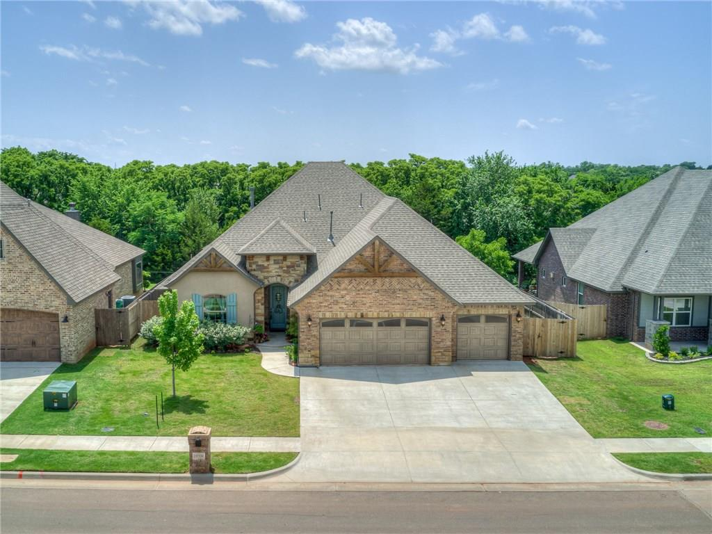 It's all about your lifestyle in this comfortable, distinctive design in Stonebriar. Open concept with picturesque windows and breathtaking views of the private greenbelt. This home is filled with all of the features, finishes, and designer details that you want. Hand-scraped wood beams and a stone fireplace with wood mantle is featured in the living room. Modern contemporary kitchen design that blend style and function for a space that is cutting-edge, yet inviting. Don't miss the master suite... the owner's true escape from the rest of the world! Features a lavish master bath with large tub to soak away the day, walk in tiled shower, gorgeous double sink vanity, and an impressive walk in closet. On the opposite end of the home you'll find large secondary bedrooms. A perfect powder bath and mud-bench tops it all off! Not only is this an inviting space for entertaining your friends and family, but it's a beautiful place to call home and make memories for years to come. Welcome Home!