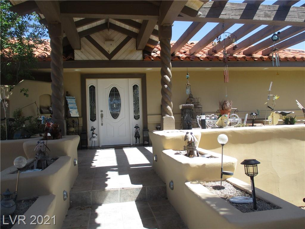 BEAUTIFUL UPDATED 1 STORY HOME ON OVER 1 ACRE W/ OVER 5100 SQ FEET, 4+ CAR GARAGE W/ EXTRA WORK SPACE, INDOOR POOL ROOM W/ PRIVATE BATH W/ SHOWER, BACK 2 ROOMS HAVE LAUNDRY HOOK-UPS & OWN ENTRY, SHED IN BACK CAN BE TURNED INTO A CASITA OR IN LAW QUARTERS HAS WINDOW AC, RV CEMENT PAD,ELECTRIC GATE TO ENTER PROPERTY, PRIVATE WELL & SEPTIC, FRESHLY PAINTED EXTERIOR, ROOF RE-ROOFED NEW UNDER LAMENT, NEW GARAGE DOORS, 3 PATIOS,TOO MUCH TO LIST*MUST SEE*PLEASE ABIDE BY ALL CDC GUIDELINES OF 6 FEET SOCIAL DISTANCING*TITLE/ESCROW IS BUYERS CHOICE*