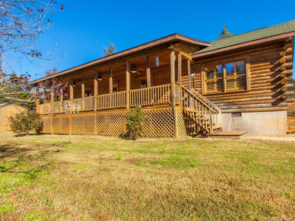 One owner  Cabin off the beaten path, with year around views on 10 acres. Single level living with open floor plan and vaulted ceilings , wood burning fireplace, 3 bedrooms with  walk in closets, large kitchen includes built in island. Covered deck to enjoy the peace and quiet and views of the year-round views  mountains. 2015 installed Salt water pool.  Pool has fencing and  private bathrooms/changing rooms directly off the pool.  10+ acres with creek access on end of the property.  There is 2nd well on upper part of the property that also includes large septic and electricity, with its own separate entrance. This property has a lot to offer. Minutes away from Lake Lure, Rutherfordton and Marion.   Agent related to seller.