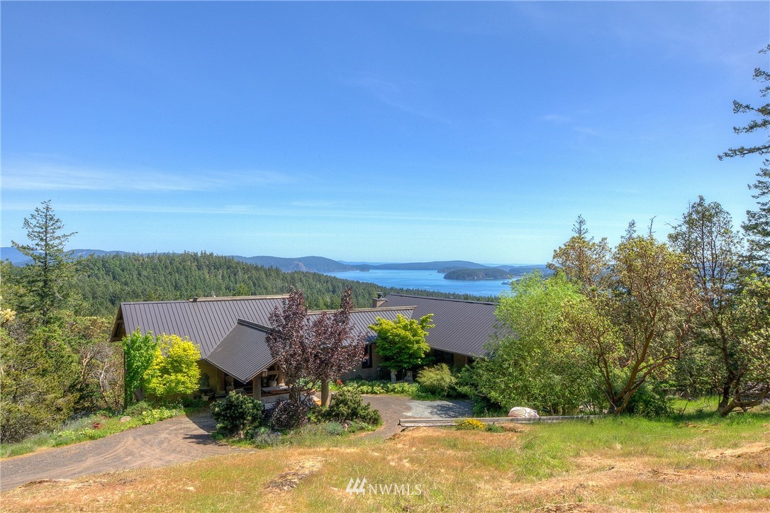 Private Estate on 19+ acres; Custom home blends contemporary w/ antique elements; complete reno/expansion w/ 5400 sf, 5 Bdrms/4.5 baths ideal for entertaining; bright airy flow; 6 fireplaces; formal dining; stunning ocean, mt, sunrise & layered island views from most rms; 1000 sf of new deck. Spacious main level bedrm w/ 2 full baths & huge closet. Carved stone & wood columns; Art Nouveau glass & bronze entry door; dome ceiling in wine cellar; Belgian fireback above dbl range w/ dbl sz hood. 2 br/2 bath guest hs nestled among trees. New 4 car exposed beam garage; 2 timber yurts in woodlands (1 w/ ocean view; 2nd w/ lake view); 2 parcels; private water system; fire suppression; near marinas & beaches. Hike your land through gardens & forest.