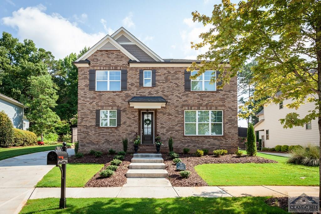 Motivated Sellers!!! Minutes from UGA. Beautiful 2 Story, Owner's Suite on main plan in Lakewood Community! Never Occupied! The main level has an open floor plan concept featuring a Family Room with a coffered ceiling, fireplace with shiplap surround and window wall overlooking the backyard. The large open kitchen has a king size island/counter top bar, dining area, custom white cabinets, granite countertops, stainless appliances with drawer microwave. Two car rear, side entry garage leads to the mudroom with access to the covered patio, laundry room and half bath. Spacious Owner's suite on main with spa like bath features including a large, tiled shower, custom, painted double vanity, spacious main closet and an additional smaller closet. The staircase is tucked away in the back of the home with entry to a large, open loft area. Also, upstairs are 3 secondary bedrooms, one with a private bathroom, and a hall shared bathroom for the other 2 secondary bedrooms. All 3 large secondary bedrooms have walk-in closets. Features to this home include durable wood-like LVP on the main excluding the owner's suite, laundry room and bath. Back yard has a privacy fence on 3 sides. Pool and clubhouse will be built in phase 2.